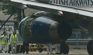 Engineers inspect the damage to BA's Airbus A319 following its emergency landing at Heathrow