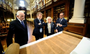 Professor Mauro Perani (who made the discovery) and other members of staff examine the world's oldest Torah scroll found in the storehouse of Bologna's university library. It is believed that the scroll is at least 800 years old, and was probably written between 1155 and 1225. Photograph: Mario Carlini/Iguana Press/Getty Images