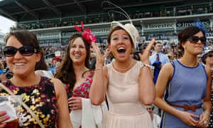 Racegoers react during Ladies Day at Epsom Derby festival.