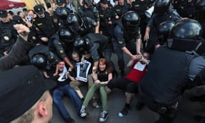 Russian riot police move in to detain demonstrators during an unauthorised protest to defend Article 31 of the Russian Constitution in St. Petersburg. Supporters of various opposition parties gathered for a rally to the article, which states that 'Citizens of the Russian Federation shall have the right to gather peacefully, without weapons, and to hold meetings, rallies, demonstrations, marches and pickets'.