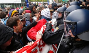 Demonstrators struggle with German police as part of the Blockupy protests outside Frankfurt airport.