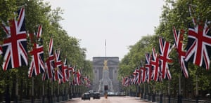 Union flags line the Mall leading to Buckingham Palace. The Queen marks the 60th anniversary of her coronation on Sunday. Photograph: Justin Tallis/AFP/Getty Images