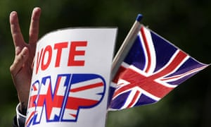 """A supporter holds a union flag and """"Vote BNP"""" sign"""