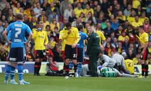 Goalkeeper Jonathan Bond is treated.