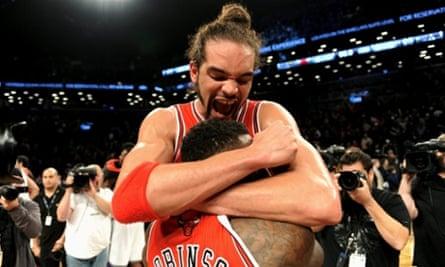 Chicago Bulls' Joakim Noah hugs Nate Robinson after beating Brooklyn Nets