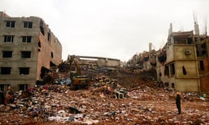 Excavators clear debris