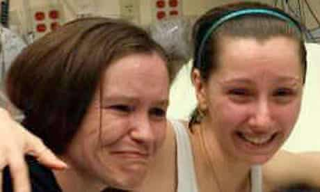 Amanda Berry (right) reunited with her sister after being found in Cleveland, Ohio