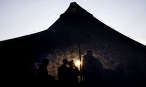 Israeli soldiers of the Golani brigade gather in a tent, as the sun rises, before a military exercise in the Israeli controlled Golan Heights, near the border with Syria.