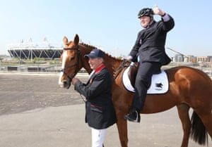 Isn't that a bike helmet? Olympic Gold medalist Nick Skelton and Boris Johnson at the launch of the Longines Global Champions Tour, an international show jumping event that will take place adjacent to Queen Elizabeth Olympic Park in east London. The event aims to secure the equestrian Olympic Legacy.