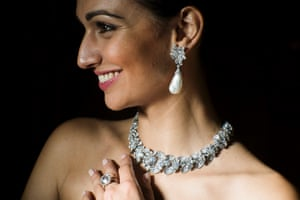 That's a lot of bling. A model poses wearing a diamond necklace and bracelet by Bulgari and natural pearl and diamond pendant earrings and a diamond ring from the collection of Italian actress Gina Lollobrigida during an auction preview at Sotheby's in Geneva, Switzerland.