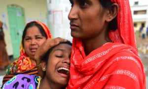 A Bangladeshi relative reacts after identifying the body of her father killed in last week's building collapse in Savar, Bangladesh as the death toll passed 700.