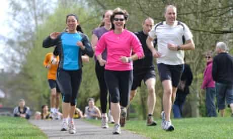 A running group training on a canal towpath