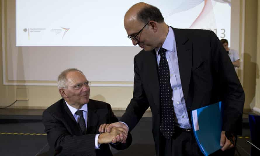 French Finance Minister Pierre Moscovici (R) takes leave of German Finance Minister Wolfgang Schaeuble at the end of a press conference at the finance ministry in Berlin on May 7, 2013, on the occasion of the 25th anniversary of the Franco-German Economic and Financial Council.