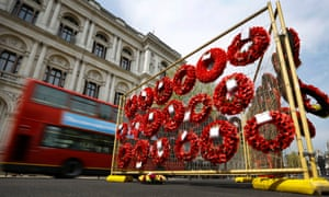 Wreaths from the Cenotaph hang on a temporary stand along Whitehall in London. English Heritage are preparing the Cenotaph for the forthcoming First World War centenary commemorations as the Cenotaph's Portland stone is naturally susceptible to weathering and pollution and a more thorough cleaning is now needed.