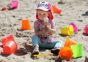 Enjoy it while it lasts. Two year old Sophie Sheridan from Glasgow enjoys an ice cream in the hot weather whilst playing in the sandpit at Blair Drummond Safari Park near Stirling.