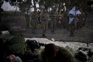 Israeli soldiers of the Golani brigade gather for the morning prayer before a military exercise in the Israeli controlled Golan Heights, near the border with Syria.