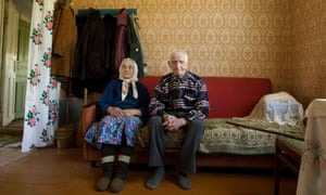 World War Two veteran Pavel Khamluk, 95, and his wife Ekaterina at their home as they prepare for Victory Day celebrations on May 9, in the town of Zhitkovichi, Belarus.