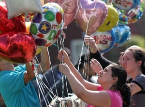 People place balloons in front of the home of Gina DeJesus in Cleveland, Ohio. Gina DeJesus, Amanda Berry, and Michelle Knight were found yesterday, after being missing for around 10 years.