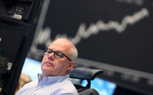 A broker is seen in front of the German Stock Market Index DAX  at the stock exchange in Frankfurt, Germany, on May 7, 2013.