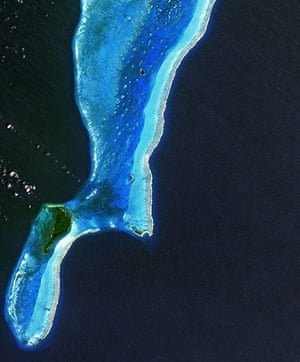 Satellite Eye on Earth: Great Blue Hole.The Lighthouse Atoll in the Belize Barrier Reef