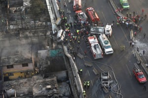 Aerial view shows first responders working next to destroyed homes and vehicles after a gas tanker truck exploded on a highway in the Mexico City suburb of Ecatepec.  The blast killed and injured dozens, according to the Citizen Safety Department of Mexico State.