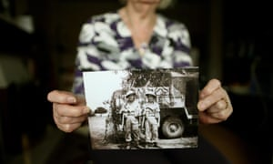 An official rehabilitation, at last: Paddy Reid's daughter-in-law holds a picture of Paddy Reid (left) with his brother Frederick taken in Burma during World War Two at their home in Balbriggan, Co Dublin, on the day Minister for Justice Alan Shatter granted amnesty to Irish soldiers who were blacklisted and shunned for joining the British Army to fight Nazi Germany after almost 70 years. Photograph: Julien Behal/PA