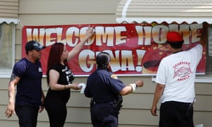 Well-wishers put up a welcome home sign at Gina DeJesus' home in Cleveland, Ohio in anticipation of her homecoming. Amanda Berry, Gina DeJesus and Michelle Knight were found alive after having been held hostage for nearly 10 years. Photograph: David Maxwell/EPA