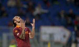 AS Roma Argentine forward Pablo Daniel Osvaldo reacts after missing a goal opportunity against Chievo during their Italian Serie A football match at Rome's Olympic stadium.