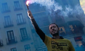 A demonstrator in T-shirt saying 'youth without future' protesting in Madrid