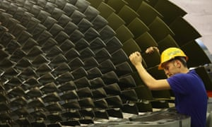 A worker rotates a gas turbine during assembly at the Siemens gas turbine factory on January 8, 2010 in Berlin, Germany.