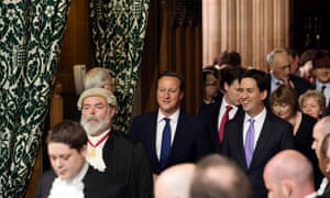 David Cameron walks with tEd Miliband as they walk through the Central Lobby towards the House of Lords to hear Queen Elizabeth II deliver the Queen's speech.
