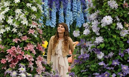 An exhibitor with clematis and delphiniums