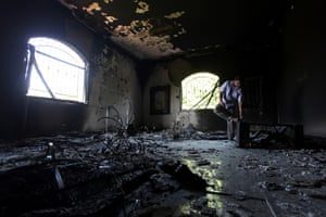 In this Thursday, Sept. 13, 2012 file photo, a Libyan man investigates the inside of the U.S. Consulate after an attack that killed four Americans, including Ambassador Chris Stevens, on the night of Tuesday, Sept. 11, 2012, in Benghazi, Libya.
