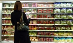 A shopper looks at packaged vegetables in Marks and Spencer