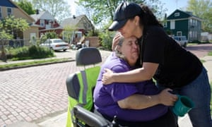 Deborah Knight, grandmother of Michelle Knight, is hugged by a neighbour outside her home in Cleveland, Ohio. Three Cleveland women, including Michelle, were found alive after vanishing in their own neighborhood a decade ago.