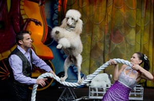 20 Photos: circus performer Hans Klose and his wife hold a rope for their performing dog