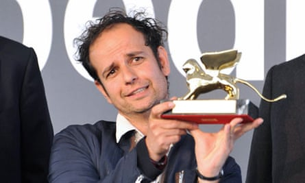 Tino Sehgal displays his Golden Lion award for best artist at the Venice Biennale