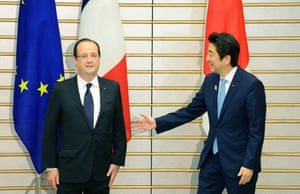 French President Francois Hollande (L) is welcomed by Japanese Prime Minister Shinzo Abe (R) prior to their summit meeting at Abe's official residence in Tokyo on June 7, 2012.