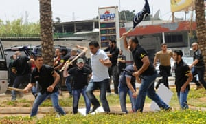 Security guards at the Iranian embassy in Beirut clash with supporters of the Lebanese Affiliation Party during a protest over Hezbollah military intervention in Syria.