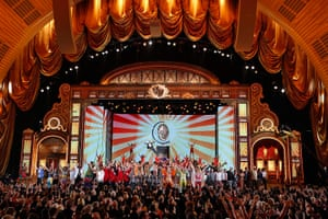 Tony awards: Host Neil Patrick Harris, hangs from a large replica of the Tony Award