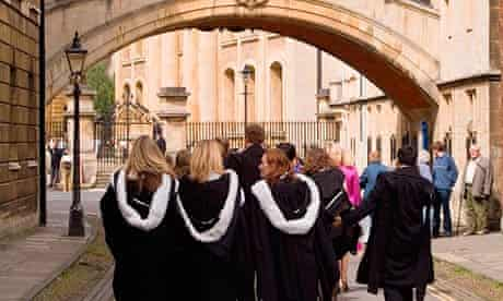 Oxford University graduates walking towards the Sheldonian Theatre