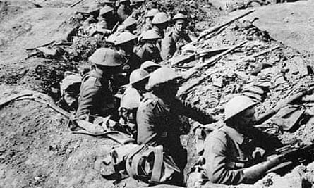 British infantrymen in a shallow trench before an advance during the Battle of the Somme