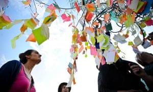 The 'Capul tree, adorned with small notes containing protesters' wishes, in Taksim Square, Turkey
