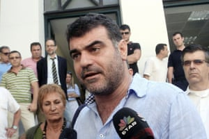 Greek investigative journalist Costas Vaxevanis (C), who was acquitted last year over the publication of leaked Swiss bank account data, speaks to the media outside a court in Athens on June 10, 2013, as part of his second trial on the same charge, which was postponed today to October 2013.