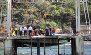 Australian authorities assist asylum seekers who survived their vessel capsizing off Christmas Island, on Sunday.