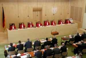 The President of the German Constitutional Court (Bundesverfassungsgericht) Andreas Vosskuhle (5th L) with other judges of the second senate opens a hearing at the court in Karlsruhe, June 11, 2013.