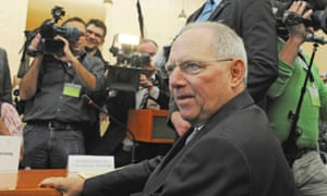 German Finance Minister Wolfgang Schaeuble waits for the start of the hearing at the Constitutional Court in Karlsruhe, June 11, 2013.