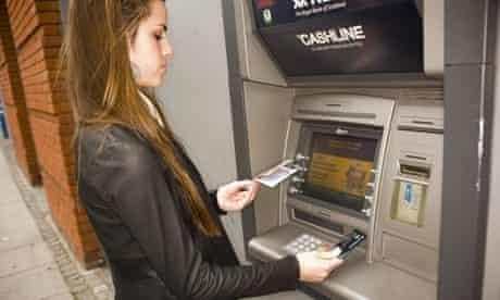 Woman using a cashpoint