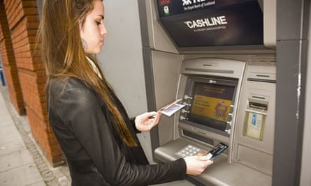 Woman using a cashpoint