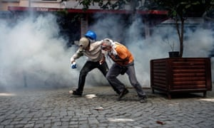 Demonstrators try to escape tear gas and rubber bullets to clear protesters. See more from the protests in Turkey here